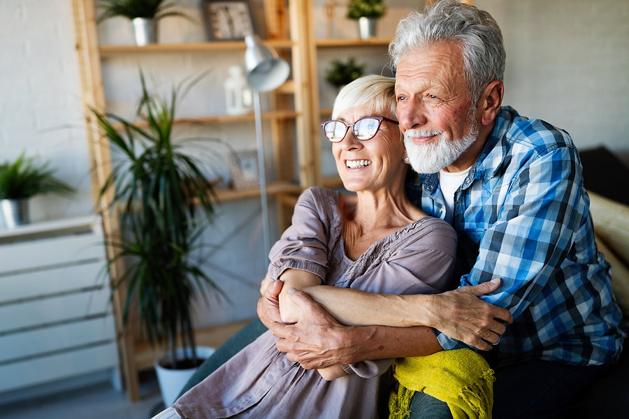 happy-smiling-senior-couple-embracing-to