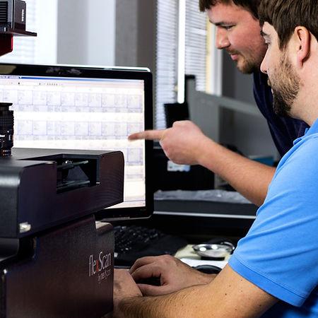 men scanning microfilm