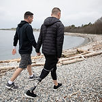 Gay Couple Walking on Beach