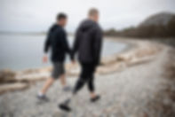 Gay Couple Walking on Beach, people with disabilities