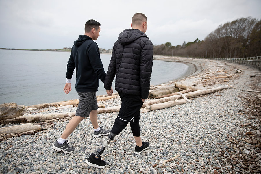 Gay Couple Walking on Beach