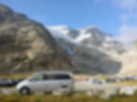Campervan on a parking site in the Alps