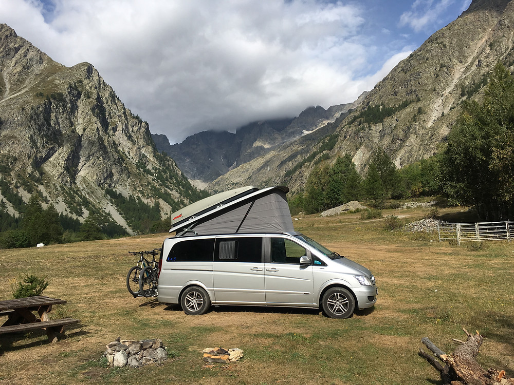 Camper van on a campground in the Alps