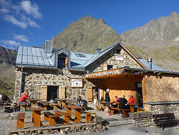 Stoney mountain hut with restaurant in the Alps