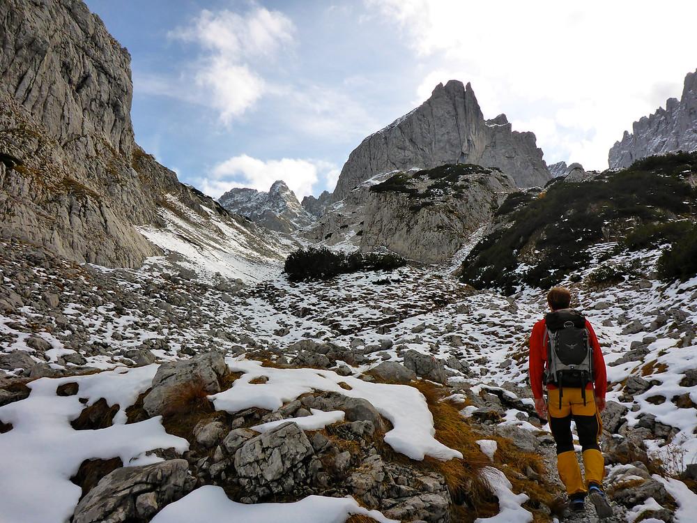 Hiker standing in alpine region covered in snow