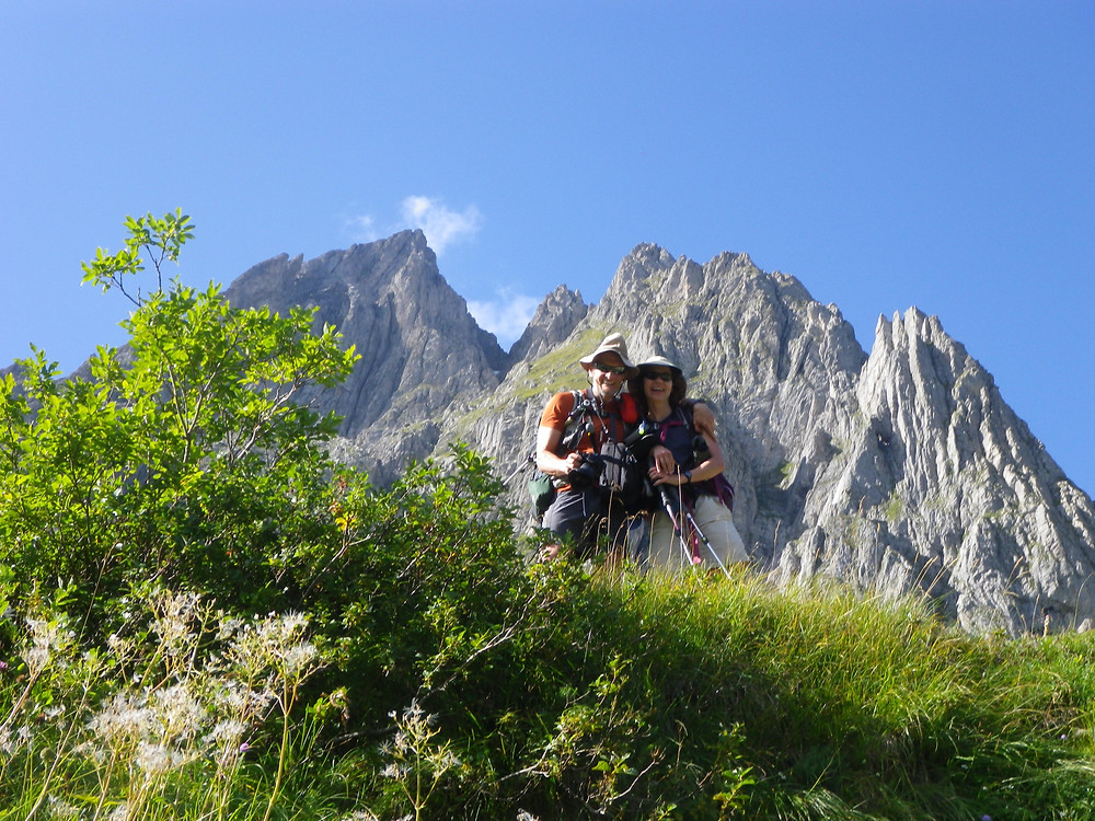 Hiking couple on Tour du Mont Blanc having a mountain pike in their back