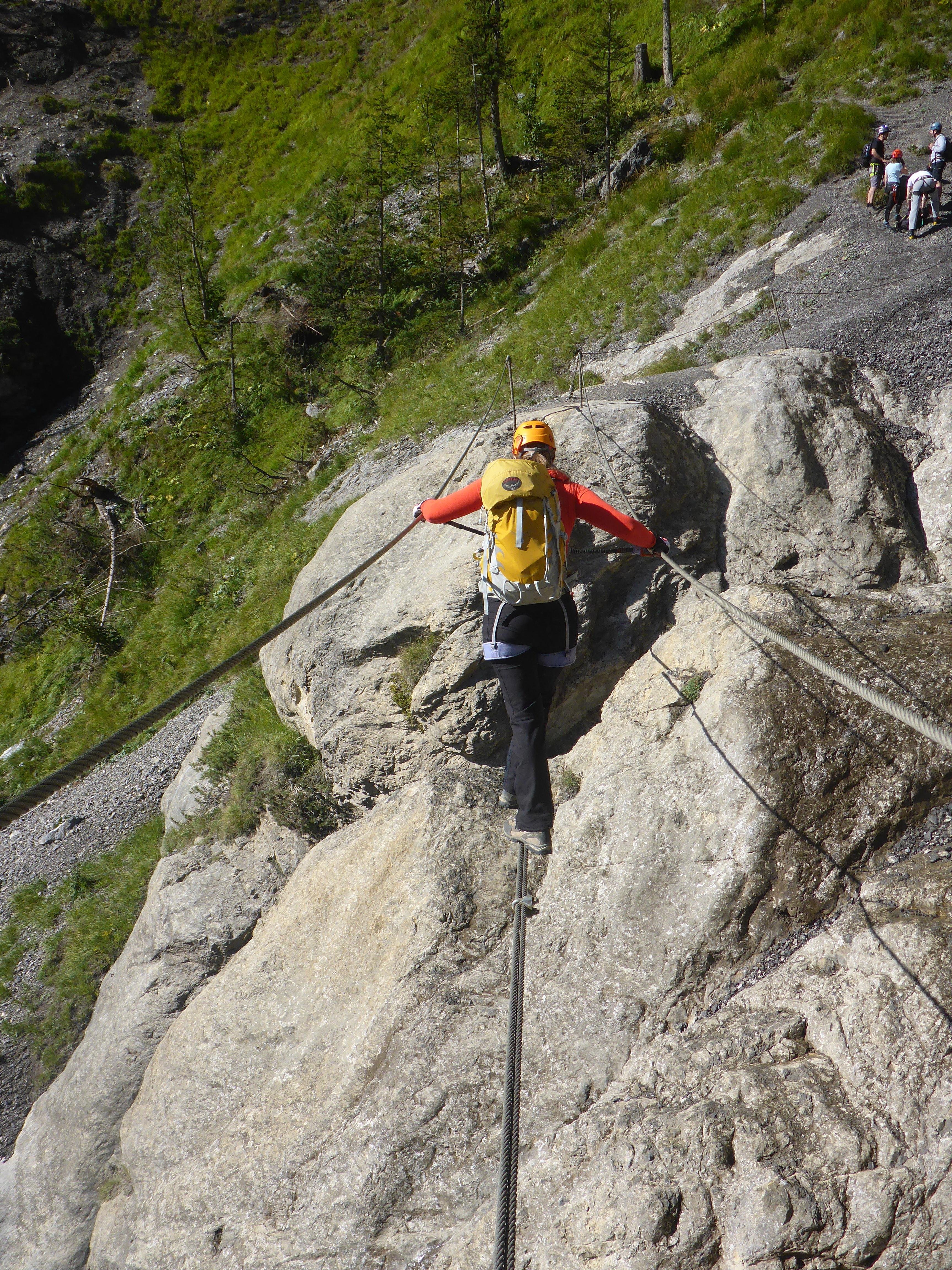 Climber using cables on Via Ferrata