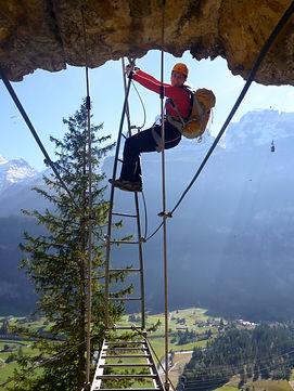 Woman on a Via Ferrata ladder
