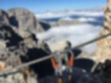 Climber's equipment on a Via Ferrata above the clouds in the Dolomites