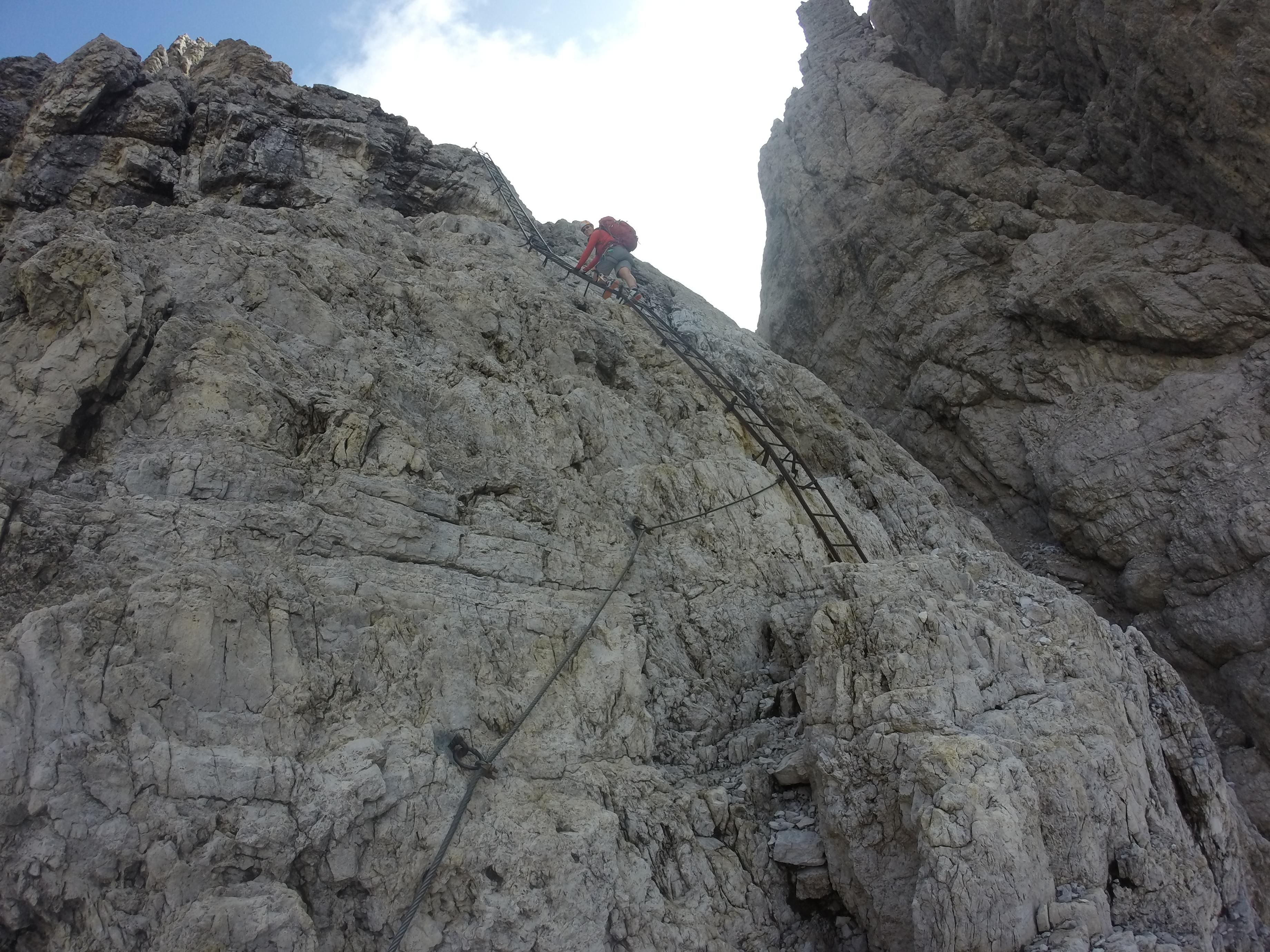 Climber using ladder on Via Ferrata