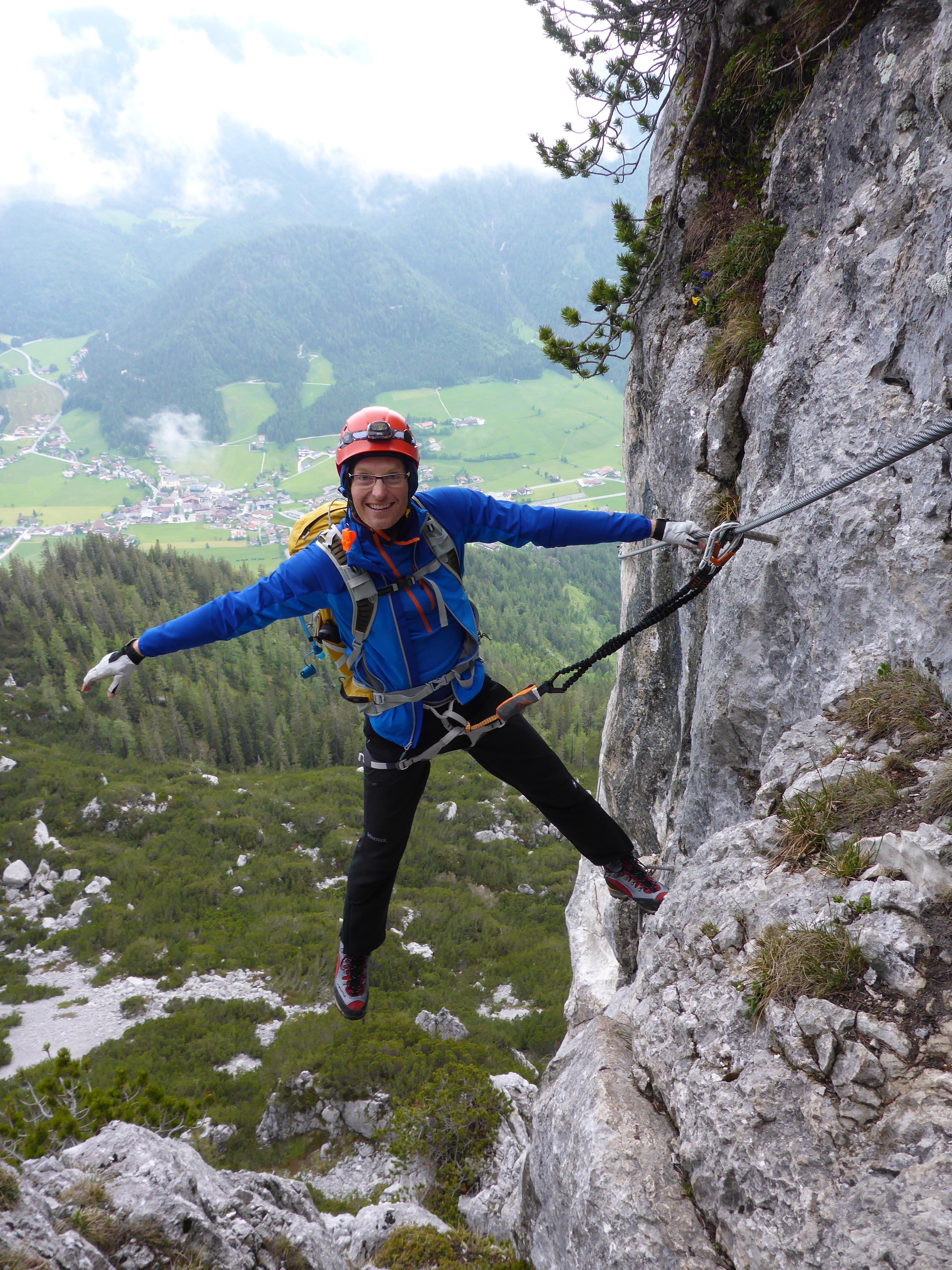 Climber in full gear on Via Ferrata