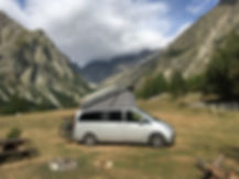 Campervan on campground in the Alps