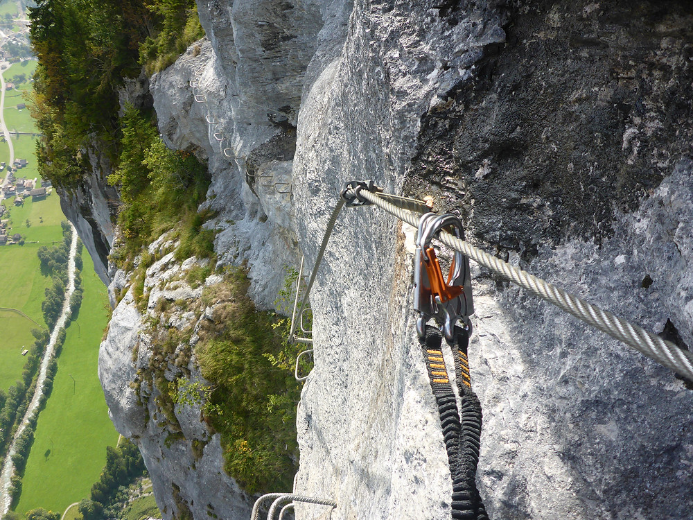 Rope and carabiner in use on a Via Ferrata in the Alps