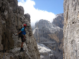 Person on a Via Ferrata in the Dolomites