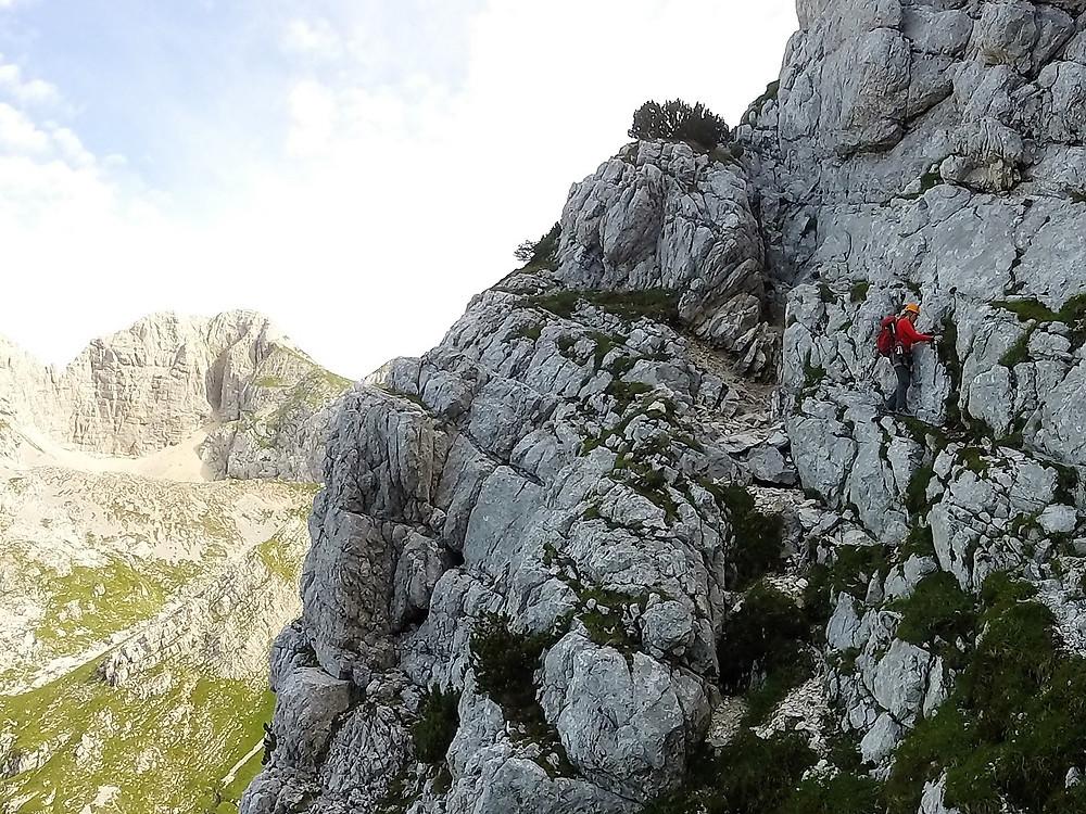 Hiker climbing the Alps in Slovenia
