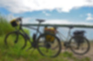 Mountain bikes in front of a lake in the Alps