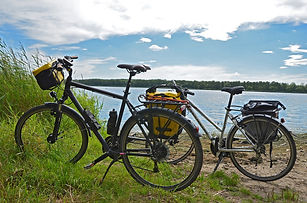 Two touring bikes in fron of a lake
