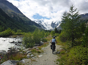 Person on a mountain biking tour in the Alps