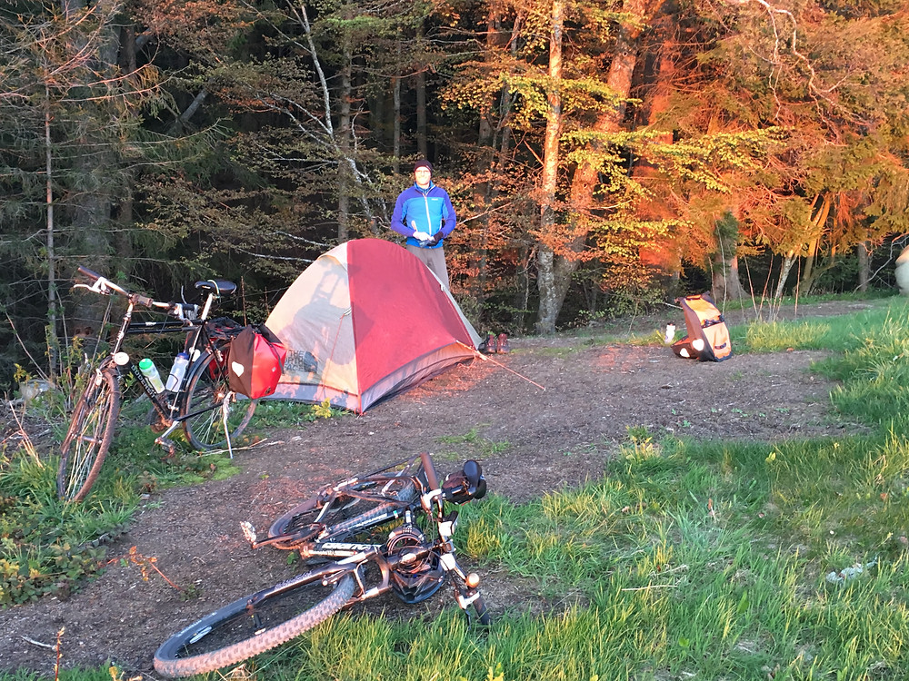 Campground with tent of touring cyclists