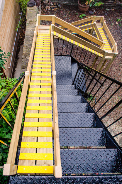 Our client needed to provide easy access into the garden for her small dog, who was unable to use the widely gapped metal staircase. We designed and built a custom made ramp on the left side of the metail staircase - both, the dog and the client were very happy.