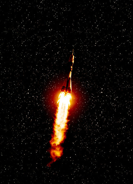 Space rocket in the outer space and star