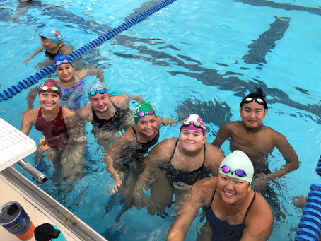 Team Gives Back with 5K Swim