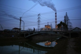 smoke-rises-from-the-chimneys-of-a-thermal-power-plant-in-shanghai.jpg