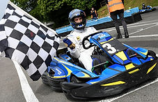Winner with Chequered Flag.jpg