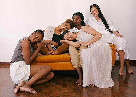 Canva - Photo of Women Sitting on Orange