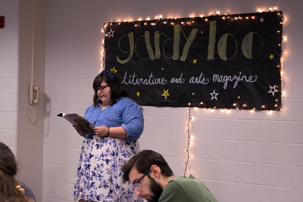 A published author reads her poem during the Spring Gardy Loo Release Party