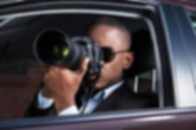92388663-private-detective-sitting-inside-car-photographing-with-slr-camera.jpg