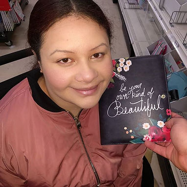 """Mandi with a planner cover that says, """"Be your own kind of Beautiful"""""""