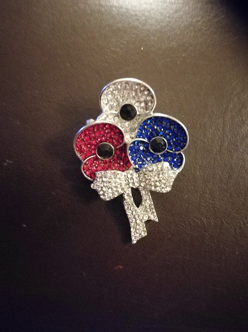 Red, white and blue triple poppy brooches