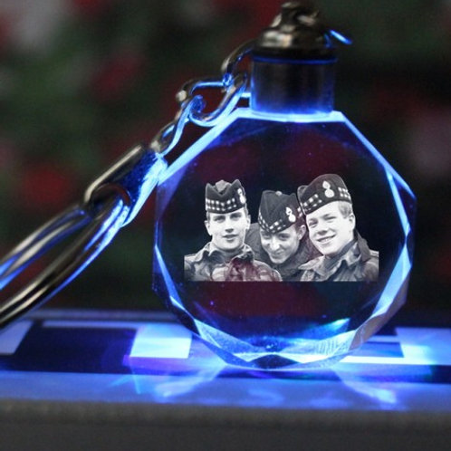 Three scottish soldiers campaign for justice light up crystal keyrings.