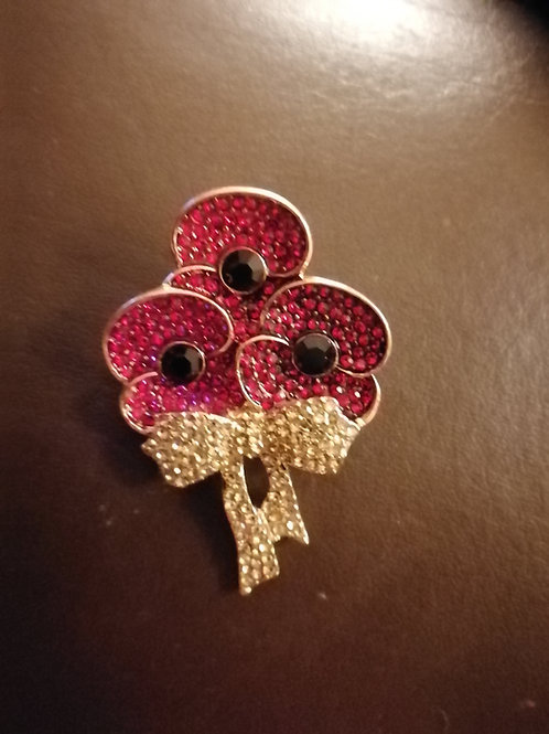 Triple red poopy brooches