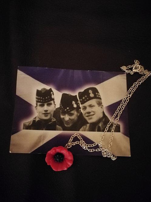 Remembrance poppy necklace.
