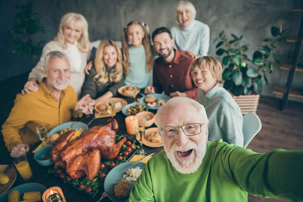 grandpa taking a selfie with his family at Thanksgivn
