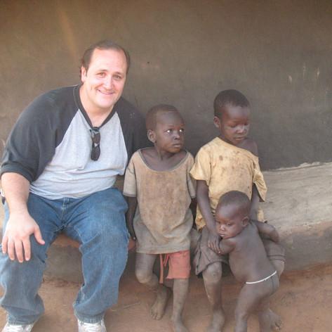 David K with new Friends in Uganda