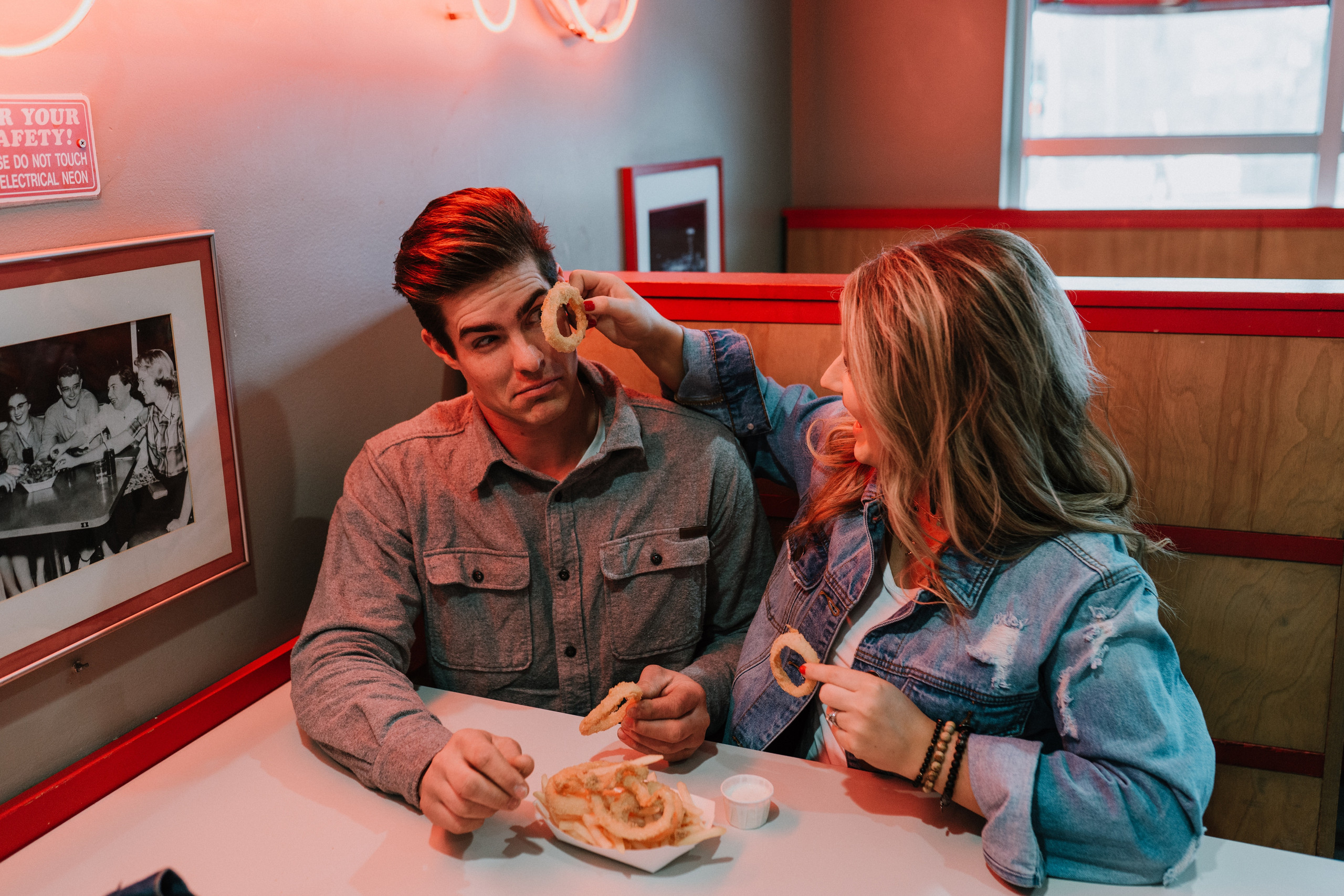 playful edgy diner engagement session with fries and onion rings omaha wedding photographer