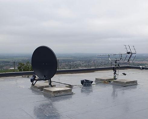 Large aerial and satellite on roof.jpeg