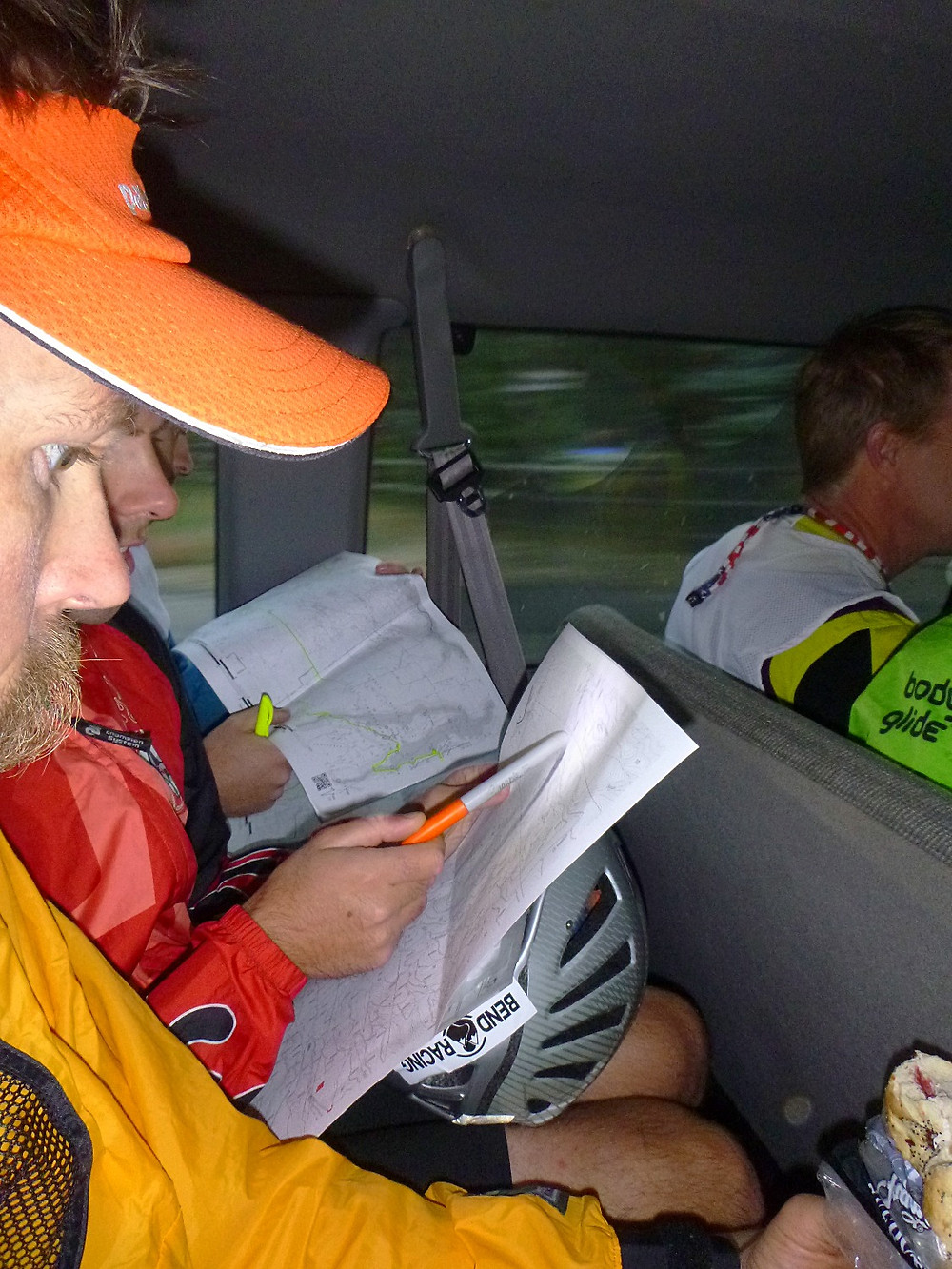 Marking up the maps & eating a little snack on the ride to the race start