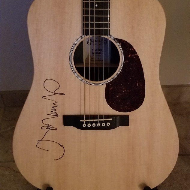 John Mellencamp Martin Guitar. Starting bid $2500