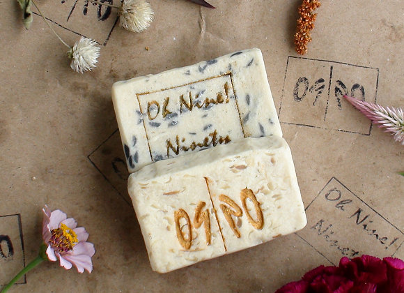 Oh Nine! Ninety 09! man-man handmade natural soap set surrounded by flowers on brown logo-stamped paper.