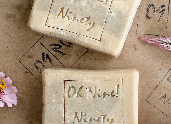 Two Oh Nine! Ninety Moringa Turmeric handmade natural soaps on brown logo-stamped paper.