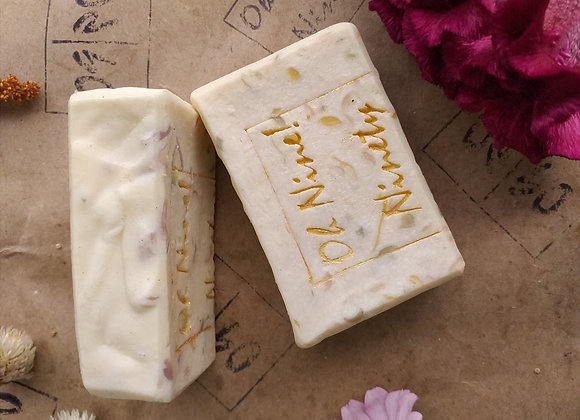 Closeup of Oh Nine! Ninety 09! Flowers soap set on brown paper.