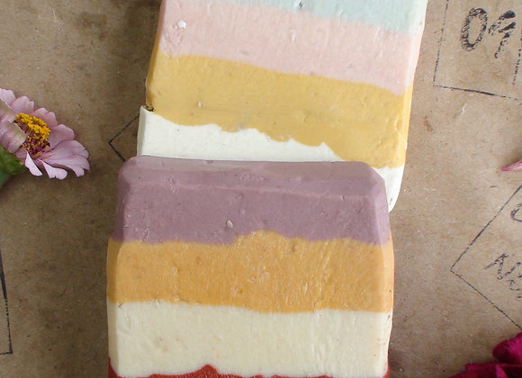 Two Oh Nine! Ninety handmade natural brine soaps with colourful striped layers on brown logo-stamped paper.