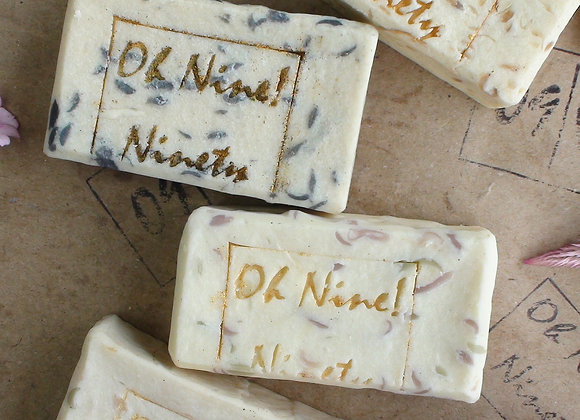 Oh Nine! Ninety Flowers & Man handmade natural soap set on brown logo-stamped paper.
