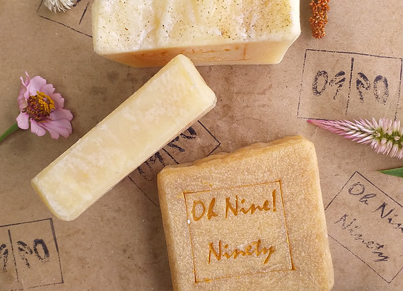 Oh Nine! Ninety Mo-Pa-Tu Herbs soap set surrounded by flowers on brown logo-stamped paper.
