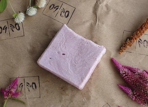 Oh Nine! Ninety pink handmade natural soap on brown logo-stamped paper.