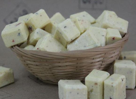 Oh Nine! Ninety handmade mini natural soaps in small brown basket.